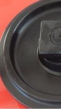 Obrázek vodící napínací kolo Idler vč. bočnic celková výška kola 539/579mm pro cat caterpillar 320 322 323 324 325 329 320 330